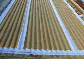 Seam Tape application on corrugated metal roof