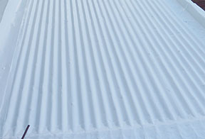 Your Last Coat application on corrugated metal roof