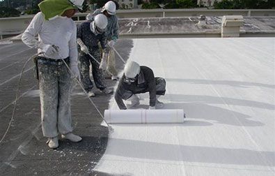 Lay Reinforcement Fabric into first coat of RoofCoat™  and backroll